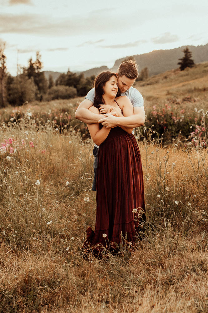 Couple canoodling in the wildflowers